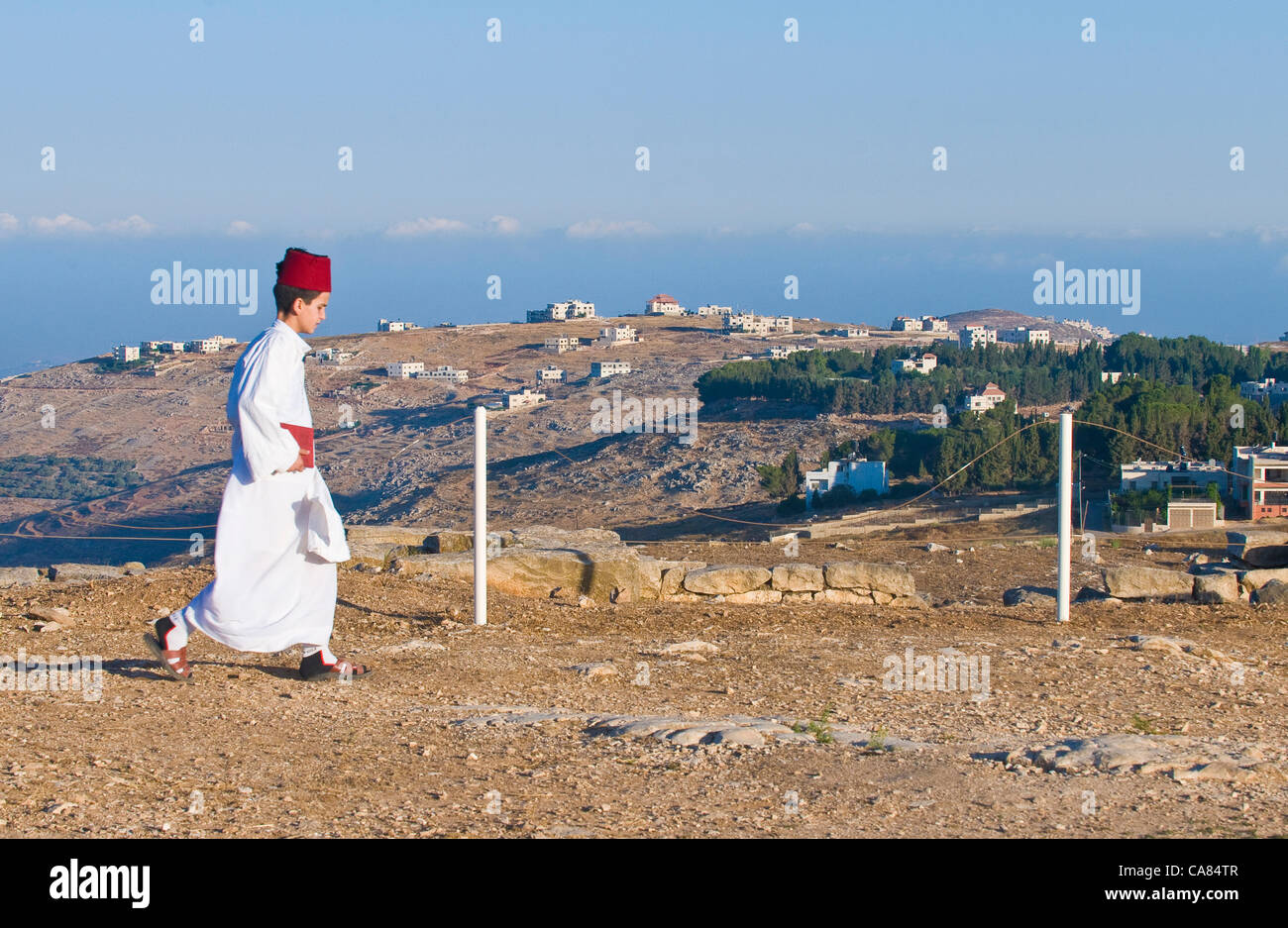 NABLUS, WEST BANK - JUNE 24 : Young Member of the ancient Samaritan community during the holy day of Shavuot in Stock Photo